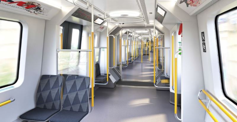 Interiören på den nya vagnen C30. Det är bredare mittgång än tidigare och färre säten.