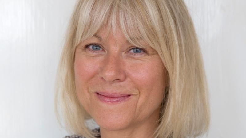 Porträttbild på Kristina Kappelin. I inslaget beskiver hon sitt utseende.