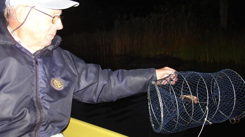Fiskare med redskap